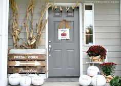 Love this unconventional fall porch decor using white, black and deep red via @Taryn H {Design, Dining + Diapers}