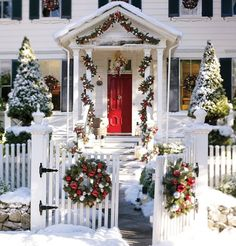 White Christmas House With Decorations Outdoor Christmas Decoration Ideas. Beautiful, traditional Colonial chrismas decor from picket fence gate to column portico and wreaths in every shuttered window. Christmas Porch, Noel Christmas, Outdoor Christmas Decorations, Winter Christmas, Christmas Lights, Christmas Wreaths, Christmas Entryway, House Decorations, Country Christmas