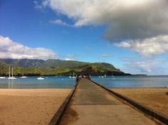 """Historic Hanalei Pier with the """"Bali Hai"""" mountains as your backdrop, a perfect place for a beach day. Kauai, Hawaii"""