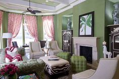Green grass cloth wall covering provides the backdrop for layers of textures and patterns in this transitional family room setting.