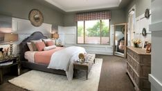 Traditional Master Bedroom With Contemporary Accents And Upholstered Bed And Headboard