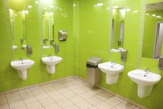 Lime Green Bathroom With White Sinks And Chrome Fixtures