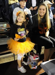 Zofia Pires, 3, of Stoughton and her mother, Zory, watch Friday night's Foxboro-Stoughton football game. Marc Vasconcellos/The Enterprise, Purchase this photo, $8