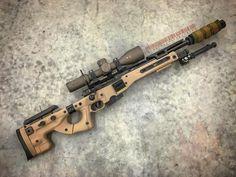 Accuracy Internation Arctic Warfare Precision Rifle with the AICS Side-Folding, Thumbhole Stock/Chassis System. Very, very slick looking rig. Sniper Rifles, Tactical Rifles, Firearms, Shotguns, Airsoft Guns, Weapons Guns, Guns And Ammo, Armas Ninja, Long Rifle