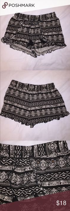 Tribal Print Shorts Black and white tribal print with ruffled edges and detailing. Never worn, was to tight. I don't recommend if you have a big butt. Thin flowy material PacSun Shorts