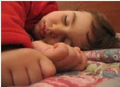 One drug free method of helping your child fall asleep at night is to place a cold pack or cold spa neck wrap on the back of the neck 15 minutes prior to bedtime. This causes the body to naturally release melatonin, aiding him or her to fall asleep.