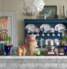 Eclectic boho maximalist style kitchen, love the blue china cabinet.