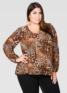 5dec38fa8b526 Animal Print Tulip Back Blouse From the Plus Size Fashion Community at  www.VintageandCurvy.