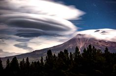 A lenticular cloud hovers above Mount Shasta, California.