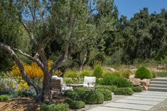Set at the base of the Santa Barbara back country, a dated ranch style home  underwent a full remodel and transformed into a modest farmhouse that lives  large, both inside and out. The full landscape renovation created  functional spaces, outdoor rooms, hidden treasures for children, all the