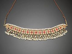 An Indian gem-set enamelled gold Choker ( guluband ). Jaipur, 19th Century
