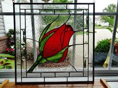 Rosebud in the Rain stained glass window panel