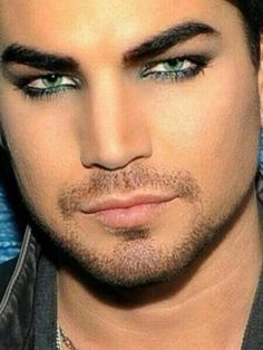 Adam Lambert, man those eyes, those lips. You could sing to me anytime...