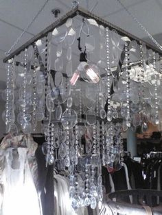 Shut up.. chandelier/Wind Chime made from old eyeglass lens.  I gotta go to resale shop for old glasses.. lol