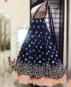 How gorgeous does this pearl beauty look on a deep navy with a soft touch of pastel peach! Indian Wedding Gowns, Indian Gowns Dresses, Indian Fashion Dresses, Dress Indian Style, Pink Gowns, Indian Designer Outfits, Indian Outfits, Lehenga Designs, Saree Blouse Designs