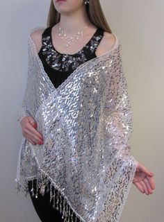 Lovely white sparkly shawl with silvery beauty to make the bride look amazing. Get one for an evening dress or prom dress today.