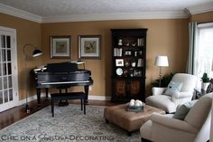 """Grand Piano Living Room. Tucked into the corner. This way violin students would be behind me, instead of in the piano nook. Maybe pull it away from the wall a few feet, and have the seating area pulled to face the keys? Then the violin/voice students could use the traditional """"nook"""" performance set-up."""