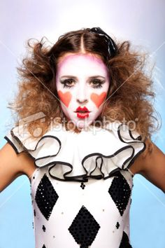 Female model posing as a harlequin clown. Royalty Free Stock Photo