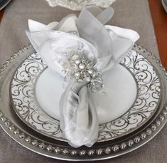 Winter Wonderland place settings with beautiful silver accents