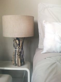 driftwood lamp DIY: Gather wood, put it around the lamp, tie with twine. The end!