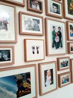 Photo wall with framed baby footprints