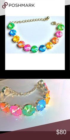 """🌈Genuine Swarovski Crystal Ultra Collection EUC🌈 Swarovski Crystals in Ultra Colors, reminds me of Candyland.  I have only worn it a couple of times so it's in pristine condition.  Need to raise money asap so I'm selling it. Sterling Silver Plated and adjustable chain to fit all wrists.  At its smallest it is 6.25"""" Swarovski Jewelry Bracelets"""