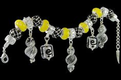 silver plated items: bracelet with lobster, enamel beads, locks, five glassdangles. Five glass beads with 925 silver core and cubic zirconia.