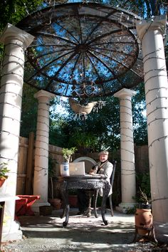 This is my gazebo office-  10 ft tall columns that a friend gave me, and guess what the 12' diameter dome is  ?  its a  recycled satellite dish.  the ship chandelier is covered with crystals and looks great at night, also have lights on the columns and the dome