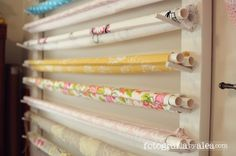 This really amazing studio idea allows for storage of backdrops in a cute way, without wrinkles. She also adds a tidbit of help - use two pipes at each end! the tension helps to reduce wrinkles and pulls the fabric tight. I love that she uses fabric, I could easily buy two or three yards of fabric for MUCH cheaper than I do actual backdrops.
