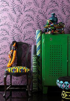 green cabinet + purple wallpaper
