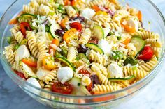 Easy Homemade Pasta Salad Recipe // Fresh and easy pasta salad packed with crisp vegetables, fresh mozzarella, and tossed with a simple homemade dressing. The perfect side dish! pasta Quick and Easy Pasta Salad Pasta Salad For Kids, Salads For Kids, Healthy Pasta Salad, Pesto Pasta Salad, Vegetarian Salad Recipes, Pasta Salad Italian, Salad Recipes For Dinner, Greek Pasta, Vegetarian Soup