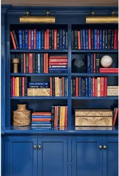 Mark D. Lacquered blue bookcases stretch across a single wall in the media room, giving the subterranean seating area the tucked-away feel of a cozy—and well-appointed—library. Blue Bookshelves, Library Bookshelves, Bookcase, Home Library Design, House Design, Design Desk, Media Room Seating, Home Libraries, Built Ins