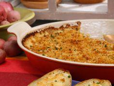 Yukon Gold Potato Gratin with Horseradish, Gruyere and Sweet Onion recipe from Geoffrey Zakarian via Food Network