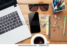 workplace with laptop coffee phone and notebook on wood desk - stock photo