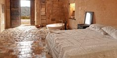Sextantio Le Grotte (Matera, Italy) - #Jetsetter  Candlelit rooms with stand-alone bathtubs and an eatery in a 13th-century church make up this romantic cave hotel