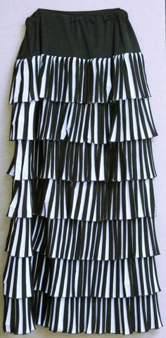 Pleated Ruffle Skirt. I am teaching this class at Bernina Connection in September.  The skirt is made of black and white stripe knit fabric.