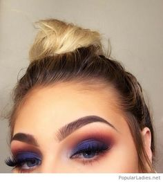 Top bun and purple eye makeup
