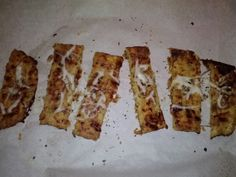 cauliflower crust breadsticks-so good, but Italian seasoning was too much on top. Note: the thinner the cauliflower the crunchier it gets!