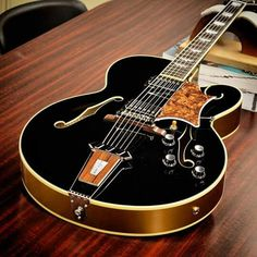 Gibson Tal Farlow Model in Ebony with Gold sides and back.