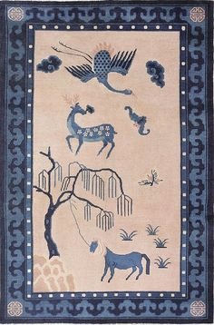 Size: 6 ft x 9 ft(1.83 m x 2.74 m) - Antique Chinese Rug, China, c. 1900's - Here is an antique Chinese composed of realistic a depiction of traditionally important Chinese animals in a simple pallet of blue and ivory. At the bottom of the piece is a tethered horse rendered in blue, with a curious expression in her eyes. Above the horse is a depiction of a deer decorated with flowers. Finally, above this, is a flying crane, also rendered in blue. The ivory of the field is bordered with blue…