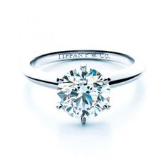 A classic design from Tiffany and Co., this solitaire diamond is held by six prongs on a platinum band.