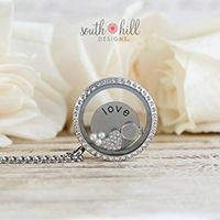 JUNE LOCKET OF THE MONTH I vow to love you in all your forms now and forever. I promise to never forget that this is a once in a lifetime love. Say 'I do' to this month's Locket of the Month! This locket features a Large Silver Tone Locket with Crystals, a shimmering Medium 'Love' Coin, the dazzling Crystal Heart and Wedding Ring Charms and three glistening Vanilla Pearls.