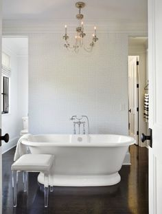 This Vintage Bath has the plumbing improved on the lovely Tub.There is a hand held Shower Head so that washing one's hair & body is e.asy.The Chandelier is glamorous