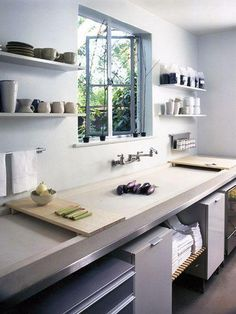 The shallow trough sink in this Pasadena kitchen by Michaela Scherrer Interior Design functions as a countertop workspace. Photo by David Phelps.