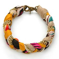 Make a textile bracelet by braiding chains with your favorite strips of fabric. Add an easy diy splash of color to your ensemble!