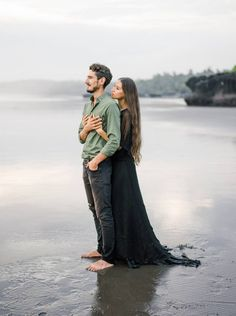 Emotive & moody engagement photos on a black sand beach via Magnolia Rouge