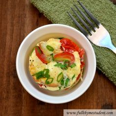 1-Minute Quick-In-A-Mug... 1 large Egg,  1 1/2 T. Milk (whole, half-half, or heavy cream),  1 tsp. melted Unsalted Butter, Pinch Salt, Pinch Pepper,  4 small halved Grape Tomatoes,  1/8 c. torn pieces Bread,  1 T. grated Cheese,  1 tsp. chopped fresh Herbs (e.g., green onions, Italian parsley, chives, etc.)...  In a microwavable mug, add egg, milk, melted butter, salt, and pepper and whisk until thoroughly mixed and egg whites are completely broken up. Add halved grape tomatoes, torn bread, grated cheese, and chopped herbs on top of egg mixture, making sure ingredients are evenly dispersed and have not settled to bottom of mug. Ingredients will stay settled within the quiche mixture better if you do not whisk ingredients into egg mixture.  Place mug in microwave, and cook on high for 1 minute, just until egg is completely cooked and quiche is slightly puffed. Garnish with fresh herbs and serve immediately.