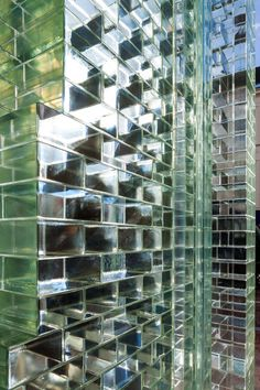 MVRDV replaces traditional facade with glass bricks that are stronger than concrete