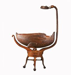 Jeannie Kasem's Little Miss Liberty Round Crib Company produces this stunning wooden Swan Cradle