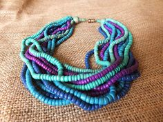 Jewel Tone Wooden Beaded Boho Necklace In Greens and Blues. $12.00, via Etsy. belly dance free spirit india summer festival style